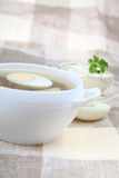 Sorrel soup. In a white plate on the table Stock Images