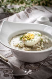 Sorrel soup with egg in white bowl. Homemade sorrel soup with egg and rice in a bowl Royalty Free Stock Photos