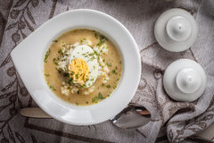 Sorrel soup with egg in white bowl. Homemade sorrel soup with egg and rice in a bowl. Top view Stock Photography
