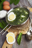 Sorrel soup with egg. On wooden table Stock Photography