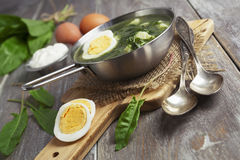 Sorrel soup with egg. On wooden table stock photos