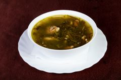 Sorrel soup with meat. And herbs stock photo