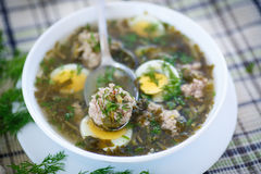 Sorrel soup with meatballs and eggs. In a bowl Stock Photos