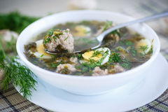Sorrel soup with meatballs and eggs. In a bowl Royalty Free Stock Image