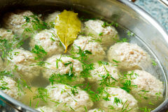 Sorrel soup with meatballs . Sorrel soup with meatballs and eggs in a bowl Stock Images