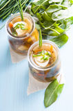 Sorrel soup in small bottles. And fresh sorrel leaves Stock Photos