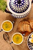 Sorrel soup in a vintage bowl with egg and bread on a wooden tab. Le stock photography