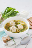 Sorrel soup in white bowl. White wood background Stock Images