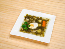 Sorrel soup. In a white square plate Stock Photo