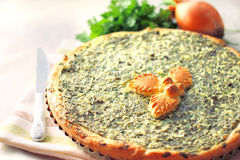 Sorrel tart with goat cheese. In baking form Stock Photography