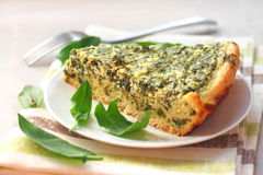 Sorrel tart with goat cheese. Piece of sorrel tart with goat cheese Stock Image