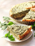 Sorrel tart with goat cheese. With a piece on a plate Stock Photos