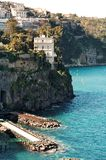 Sorrento. Rocky coastline in Sorrento with its wonderful villas on high cliffs overllooking the sea Stock Photography