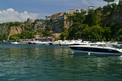 Sorrento Bay. Yachts and speed boats moored beneath the cliffs at Sorrento on the Bay of Naples, Italy stock photos
