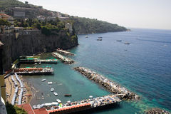 Sorrento Coast. Beach in Sorrento, Italy. People sunbathing and swimming royalty free stock photos