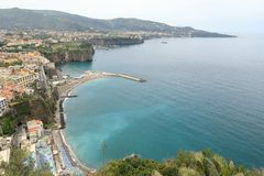 Coastline of Sorrento, Italy. Sorrento is a coastal town in southwestern Italy, facing the Bay of Naples on the Sorrentine Peninsula. Perched atop cliffs that royalty free stock photo