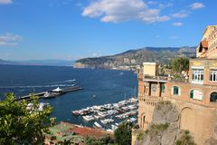 Sorrento, Italy. Ocean view of coastal features of Italy in Sorrento with cliffside houses and boat marina Royalty Free Stock Image