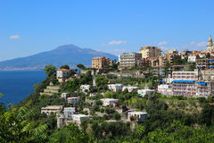 Sorrento, Italy. Ocean view of coastal features of Italy in Sorrento with cliffside houses and Mount Vesuvius in the background Stock Photography