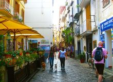 SORRENTO,ITALY - SEPTEMBER, 2012: Atmosphere of streets of Sorrento. Architecture of old colorful houses, cafes, souvenirs. shops. In narrow streets of city Stock Photography