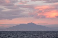 Sunset in the Bay of Naples, Italy. Mount Vesuvius can be seen on the horizon. Photographed near Sorrento . Sorrento, Italy Sunset in the Bay of Naples, Italy stock photos