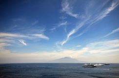 Sorrento, Italy. View toward the volcano, vesuvius, with cruise ship in foreground stock image