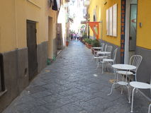 Sorrento. A Sorrento narrow alley where customers can eat and drink with passerby's mingle in relaxation Stock Photo