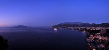 Sorrento night pan. Panorama of Sorrento and Mount Vesuvius at dusk, Naples, Italy stock photography