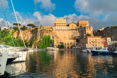 Sorrento, southern Italy. Boats embankment and city of Sorrento, southern Italy Stock Images