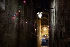 Sorrento Strech alley with archs. March 31, 2018, Sorrento - Italy, Europe. Strech alley at night with archs and colorful red, yellow and green lights and stone stock photo
