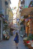 Sorrento Street Italy. SORRENTO, ITALY - JUNE 26, 2014: Narrow Street With Flags Decoration in Sorrento, Italy Royalty Free Stock Photography