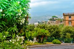 Sorrento summer cityscape. South of Italy. Sorrento summer cityscape with picturesque view on green trees, architecture and mountains. South of Italy, Amalfi Royalty Free Stock Photos