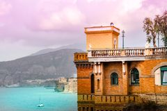 Sorrento Summer seascape view. Amalfi coast, South of Italy. Sorrento Summer picturesque seascape view on mountains, architecture and sea with pink fairy fantasy Stock Image