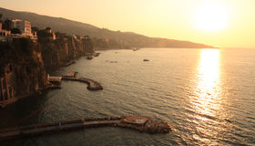 Sorrento Sunset. Sun sets over the calm bay in Sorrento, Italy Stock Image