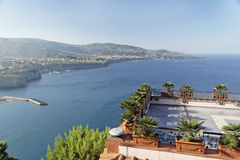 Sorrento and Vesuvius Volcano. A deck with plants and the city of Sorrento at the shore of Napoles Bay with its mediterranean blue waters. South of Italy stock photos