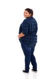 Donna più di dimensione che guarda indietro Fotografie Stock Libere da Diritti