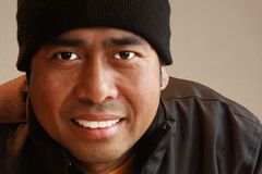 Sorridere asiatico del maschio Fotografia Stock