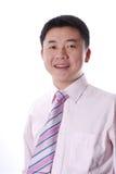 Sorridere asiatico dell'uomo di affari Immagine Stock