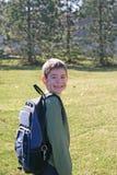 Sorridere del ragazzo pronto per il banco Fotografie Stock Libere da Diritti