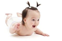 Sorridere della neonata Immagine Stock