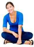 Sorridere di seduta della donna Fotografie Stock