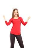 Sorridere e giovane donna felice che gesturing felicità Fotografia Stock Libera da Diritti
