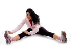 Sorridere esercitando donna su priorità bassa bianca Fotografia Stock