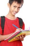 Sorridere felice dello scolaro Fotografia Stock Libera da Diritti