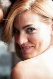 Sorridere grazioso della donna Fotografia Stock