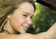 Sorridere grazioso della ragazza Fotografia Stock
