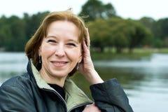 Sorridere maturo della donna Fotografie Stock Libere da Diritti