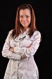 Sorridere medico attraente di medico della donna Isolato sopra il BAC nero fotografia stock