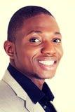 Sorridere nero astuto felice dell'uomo d'affari Fotografie Stock