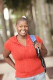 Sorridere nero maturo dell'allievo Fotografie Stock Libere da Diritti
