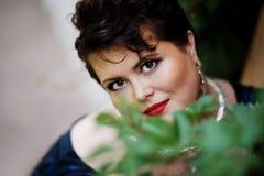 Sorridere paffuto della donna Fotografie Stock Libere da Diritti